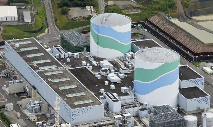 Reactors of No. 1 (R) and No. 2 at the Sendai Nuclear Power Station in Satsumasendai, Kagoshima prefecture, southern Japan.  (Hiroko Harima/Kyodo News via AP)