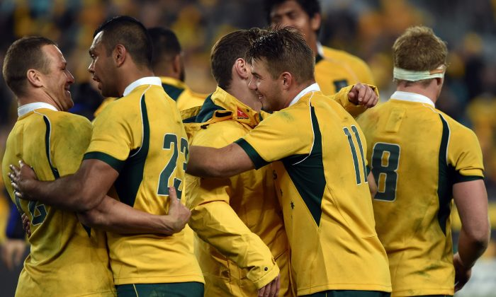 Australia's players celebrate their victory against New Zealand All Blacks in the Bledisloe Cup Test match as part of the Rugby Championship in Sydney on August 8, 2015. (Saeed Khan/AFP/Getty Images)