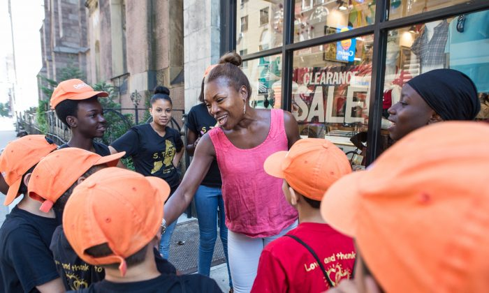 Deborah Koenigsberger  with the summer camp kids of Hearts of Gold at the Thrifty HoG store in the Flatiron District of Manhattan on July 24, 2015. (Benjamin Chasteen/Epoch Times)