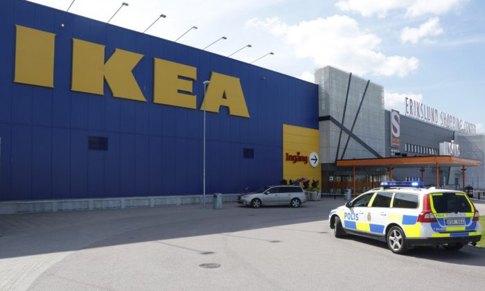 Police officers attend the Ikea store in Vasteras, Sweden, Monday Aug. 10, 2015, after three people were injured in a knife attack at the store. (Peter Kruger/TT via AP)