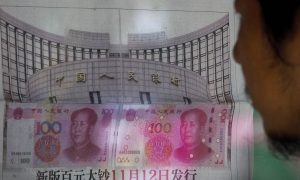China's Currency Slides After Beijing Announces Devaluation
