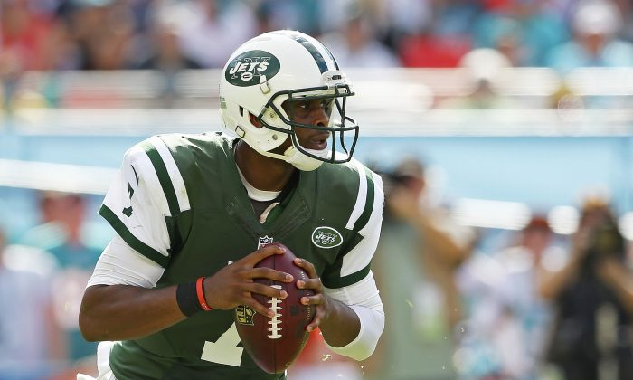 Quarterback Geno Smith #7 of the New York Jets looks for a receiver in the second quarter during a game against the Miami Dolphins at Sun Life Stadium on December 28, 2014 in Miami Gardens, Florida. (Mike Ehrmann/Getty Images)