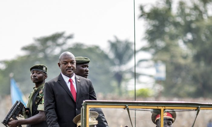 Burundi's President Pierre Nkurunziza (2L) arrives for celebrations of the country's 53rd Independence Anniversary at Prince Rwagasore Stadium, in Bujumbura, on July 1, 2015. (Marco Longari/AFP/Getty Images)