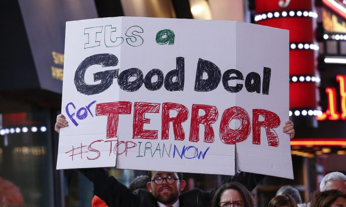 A man holds a poster during a rally against the nuclear deal with Iran in Times Square in New York on July 22, 2015. (Kena Betancur/AFP/Getty Images)