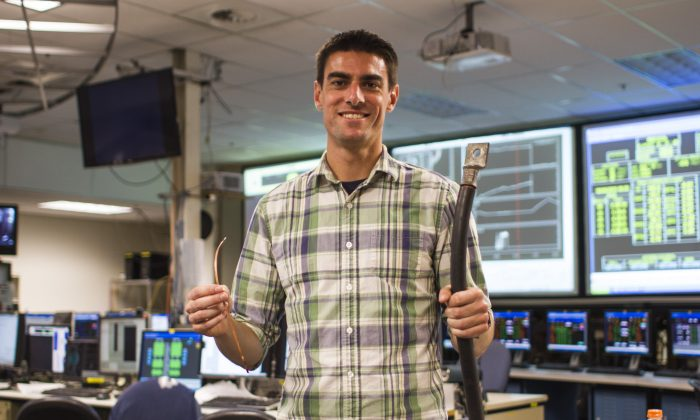 MIT PhD candidate Brandon Sorbom holds REBCO superconducting tapes (left), which are the enabling technology behind the ARC reactor. (Jose-Luis Olivares/MIT)