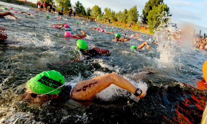 Competitors start the 2015 Ironman Boulder at the Boulder Reservoir in Boulder, Colo, Aug. 2, 2015. (Cliff Grassmich/Boulder Daily Camera via AP)