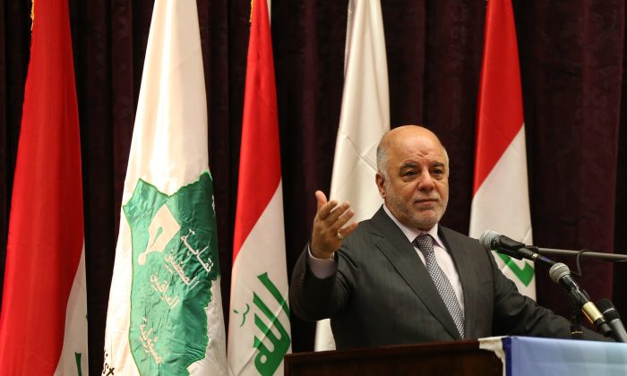 In this Saturday, June 27, 2015 file photo, Iraqi Prime Minister Haider al-Abadi announces the arrest of Abdel Baqi al-Sadun, a senior official in the disbanded Baath Party, during a press conference in Baghdad, Iraq. (AP Photo/Karim Kadim)