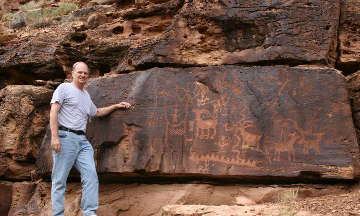 John A. Ruskamp stands near petroglyphs that match ancient Chinese script in Nine Mile Canyon, Utah. (Courtesy of John A. Ruskamp)