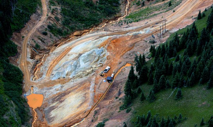 Waste water continues to stream out of the Gold King Mine near Silverton, Colo., on Tuesday, Aug. 11, 2015. (Geoff Liesik/The Deseret News via AP)