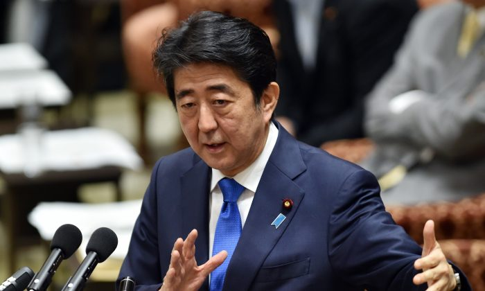 Japanese Prime Minister Shinzo Abe during a parliamentary committee discussion on his controversial security bills at the National Diet in Tokyo on July 15, 2015. (Yoshikazu Tsuno/AFP/Getty Images)