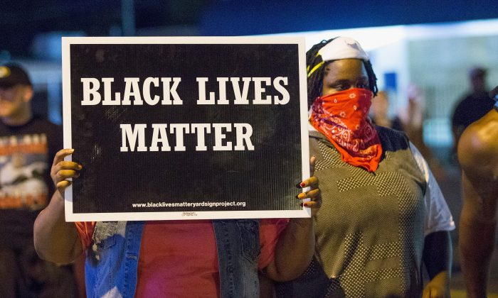 Demonstrators, marking the one-year anniversary of the shooting of Michael Brown, protest along West Florrisant Street on August 10, 2015 in Ferguson, Missouri. (Photo by Scott Olson/Getty Images)