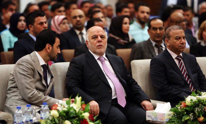 Iraqi Prime Minister Haider al-Abadi, center, attends the International Youth Day celebration in Baghdad, Iraq, Wednesday, Aug. 12, 2015. (AP Photo/Karim Kadim)