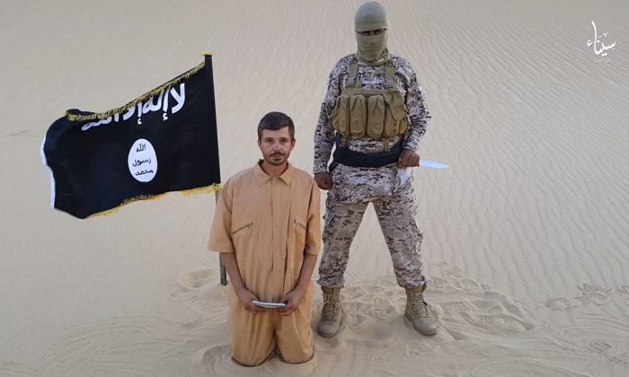 This image made from a militant video posted on a social media site on Wednesday, Aug. 5, 2015, which has been verified and is consistent with other AP reporting, purports to show a militant standing next to another man who identifies himself as 30-year-old Tomislav Salopek, kneeling down as he reads a message at an unknown location. (Militant video via AP)