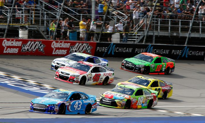 Aric Almirola, driver of the #43 Smithfield Ford, leads a pack of cars during the NASCAR Sprint Cup Series Quicken Loans 400 at Michigan International Speedway on June 14, 2015 in Brooklyn, Michigan. (Jerry Markland/Getty Images)