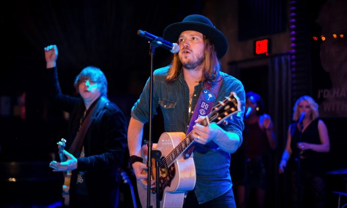 Musicians Bill Satcher (L) and Michael Hobby of the band A Thousand Horses perform at The Sayers Club on March 30, 2015 in Hollywood, California. (Christopher Polk/Getty Images for Big Machine Label Group/Republic Nashville)