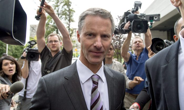 Nigel Wright, former chief of staff to Prime Minister Stephen Harper, makes his way through a crush of media as he arrives to testify at the criminal trial of embattled Sen. Mike Duffy in Ottawa on Aug. 12, 2015. (The Canadian Press/Justin Tang)