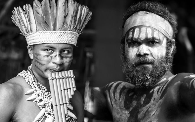 Left: A young man participates in a Native ritual in the Amazon in Brazil. (Filipe Frazao/iStock) Right: An Aboriginal man performs on Australia Day in Sydney, Australia, on Jan. 26, 2014. (PhotographyByDonnaG/iStock)