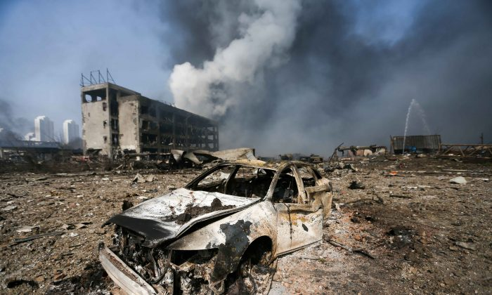A damaged car is seen on Aug. 13 at the site of the massive explosions in Tianjin. (STR/AFP/Getty Images)