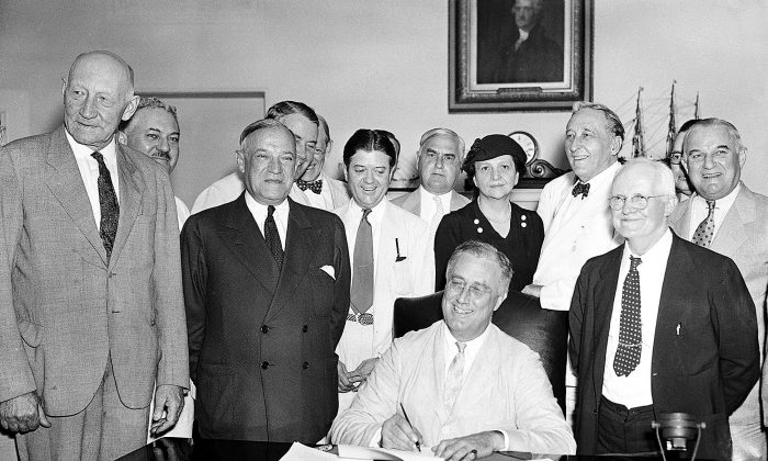 FLE - In this Aug. 14, 1935, file photo President Franklin Roosevelt signs the Social Security Bill in Washington.  (AP Photo, File)