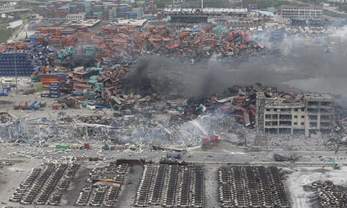 Rescuers work at the site of the explosions in Tianjin on Aug. 14, 2015. (STR/AFP/Getty Images)