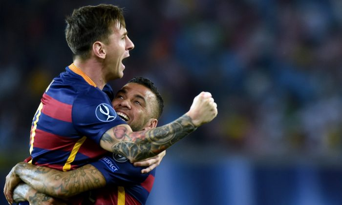 Barcelona's Brazilian defender Dani Alves (R) and Barcelona's Argentinian forward Lionel Messi (L) celebrate after scoring a goal during the UEFA Super Cup final football match between FC Barcelona and Sevilla FC in Tbilisi on August 11, 2015. (Kirill Kudryavtsev/AFP/Getty Images)