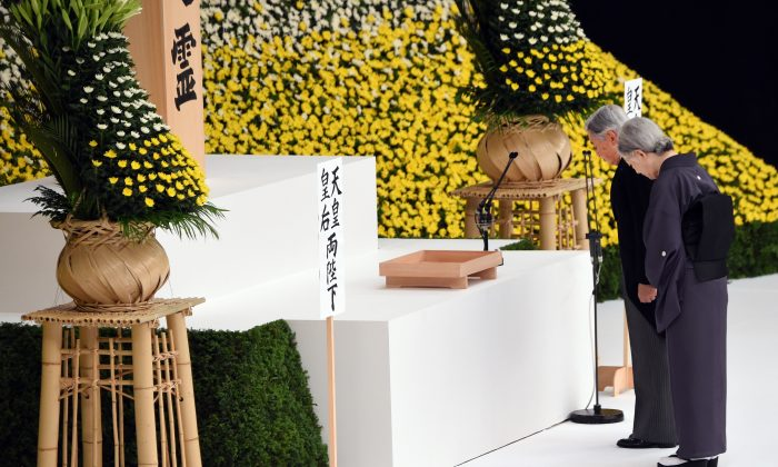"Emperor Akihito (2nd R) and Empress Michiko (R) offer silence prayers before the altar during the annual memorial service for war victims in Tokyo on August 15, 2015. Japan's emperor Akihito said on August 15 that he felt ""profound remorse"" over World War II -- a conflict that Tokyo fought in the name of his father Hirohito.  Japan marked the 70th anniversary of the end of the World War II on August 15 under criticism from neighbours China and South Korea which said Prime Minister Shinzo Abe's speech the day before failed to properly apologise for Tokyo's past aggression.  (Toru Yamanaka/AFP/Getty Images)"