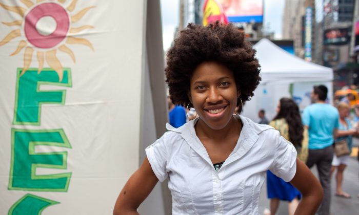 Singer Olivia Harris, aka Olivia K, at the EcoFest in Times Square, New York, on Aug. 16, 2015. (Petr Svab/Epoch Times)