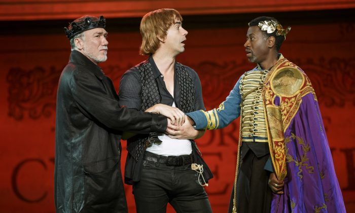 "(L–R) Patrick Page, Hamish Linklater, and Teagle F. Bougere in The Public Theater's Free Shakespeare in the Park production of ""Cymbeline."" In a refreshingly funny production, the cast play multiple roles. Here Linklater plays foolish Cloten, possibly heir to the throne. (Carol Rosegg)"