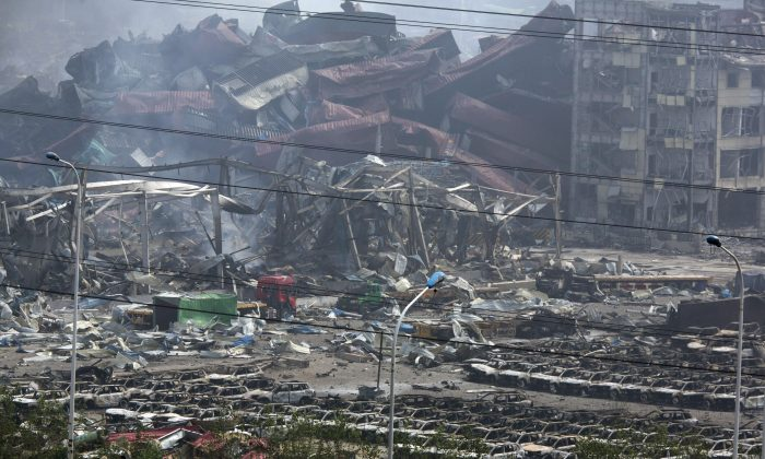 The smoking remains of the explosion in China's Tianjin municipality Saturday, Aug. 15, 2015.  (AP Photo/Ng Han Guan)