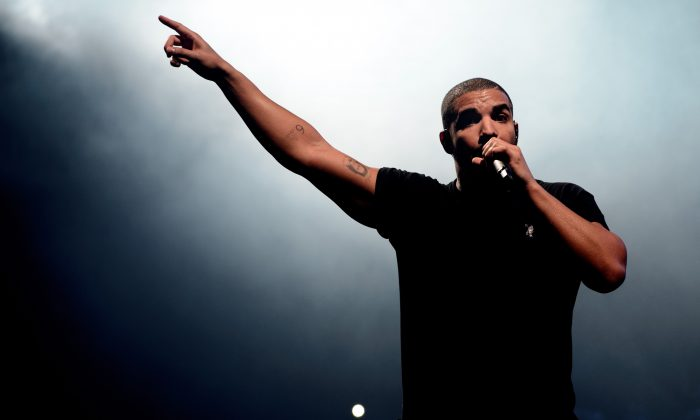 FILE - In this June 27, 2015, file photo, Canadian singer Drake performs at the Wireless festival in Finsbury Park, in London. (Photo by Jonathan Short/Invision/AP, File)