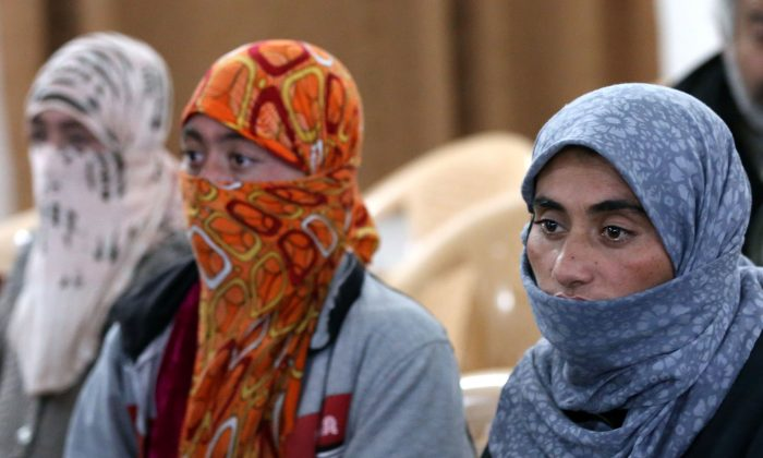 Yazidi women at Al-Tun Kopri Health Center, between the northern Iraqi city of Kirkuk and Arbil, on Jan. 17, 2015. They were released with around 200 mostly elderly members of Iraq's Yazidi minority near Kirkuk after being held by the Islamic State jihadist group for more than five months. (Safin Hamed/AFP/Getty Images)