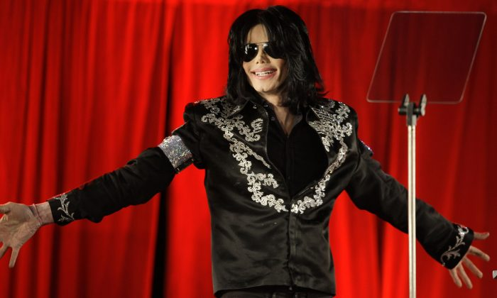 In this March 5, 2009 file photo, singer Michael Jackson announces that he is set to play ten live concerts in London. (AP Photo/Joel Ryan, File)