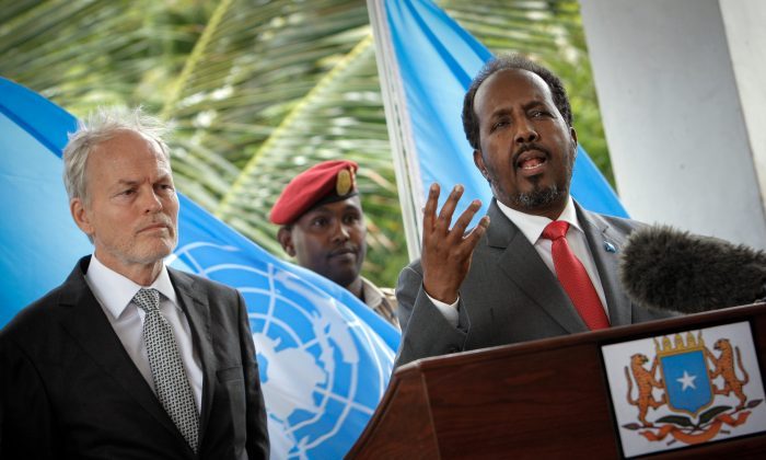 Somali President Hassan Sheikh Mohamud (R) and the head of the U.N. Assistance Mission in Somalia (UNSOM), Nicholas Kay (L), in a press conference for the peaceful resolution of conflicts in the country, at Villa Somalia, in Mogadishu, Somalia, on June 8, 2013. (Stuart Price/AFP/Getty Images)
