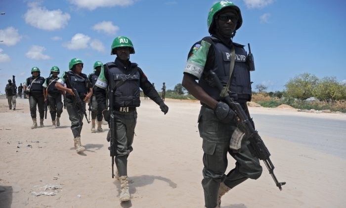 African Union Mission in Somalia (AMISOM) officers patrol around the Gashandhiga academy compound during celebrations of the 55th anniversary of the Somali military force, in Mogadishu, on April 12, 2015. (Mohamed Abdiwahab/AFP/Getty Images)