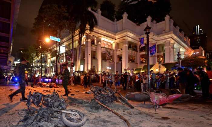 Thai soldiers inspect the scene after a bomb exploded outside a religious shrine in central Bangkok late on August 17, 2015 killing at least 10 people and wounding scores more.  Body parts were scattered across the street after the explosion outside the Erawan Shrine in the downtown Chidlom district of the Thai capital. (Pornchai Kittiwongsagul/AFP/Getty Images)