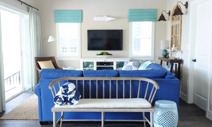 The blue sofa in the living room adds a nautical, casual, summer house feel. (Tracey Ayton, www.traceyaytonphotography.com)