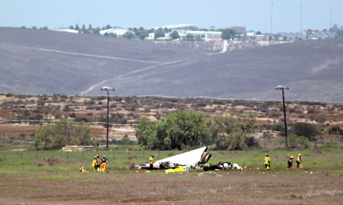 Authorities say multiple people died following the midair collision and crash of two small planes near an airport in southern San Diego County. (John Gastaldo/U-T San Diego via AP)