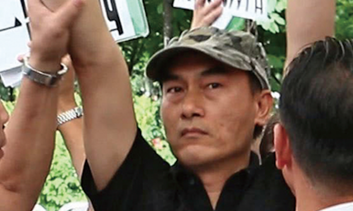 A man who is suspected as a CCP agent, has been recognized participating in the July 26 City-forum program recording site. During the recording of the City-Forum program, the man shouted loudly against host Tse Chi-fung.  (Epoch Times)