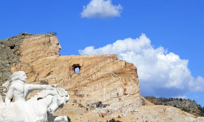 Crazy Horse Memorial circa 2014. To put the scale of the memorial in perspective, Mount Rushmore is roughly the size of Crazy Horse's face. The outstretched arm is longer than the length of a football field. The next phase of the carving is the hand above the horse's head. (Crazy Horse Memorial Foundation)