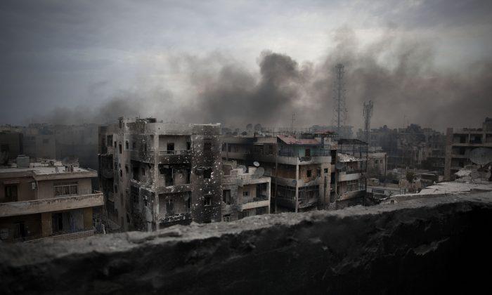 Smoke rises over Saif al-Dawla District in Aleppo, Syria, on Oct. 2, 2012. (AP Photo/Manu Brabo)
