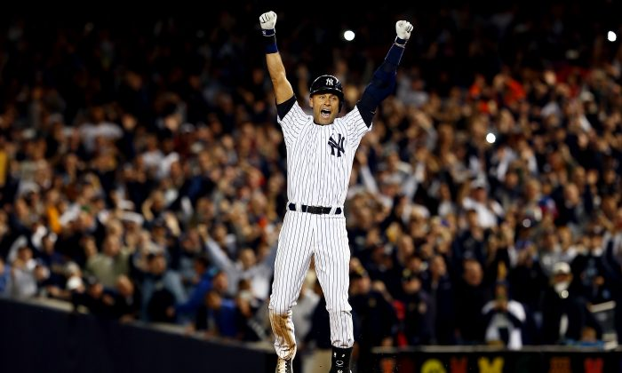 Yankee legend Derek Jeter celebrates after a game winning RBI hit in the ninth inning against the Baltimore Orioles in his last game ever at Yankee Stadium on September 25, 2014. (Elsa/Getty Images)
