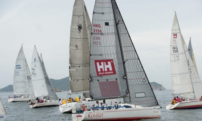 HKPN Division-A and J80 boats set off from Port Shelter on the penultimate race of the Quest Yachting Typhoon Series 2015 on Sunday August 16, 2015. (Bill Cox/Epoch Times)