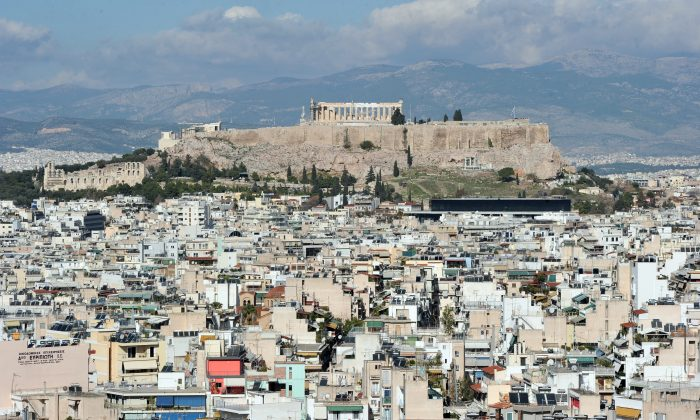 A view of Greece's capital, Athens, with the acropolis hill in the background, on Nov. 28, 2013. (Louisa Gouliamaki/AFP/Getty Images)