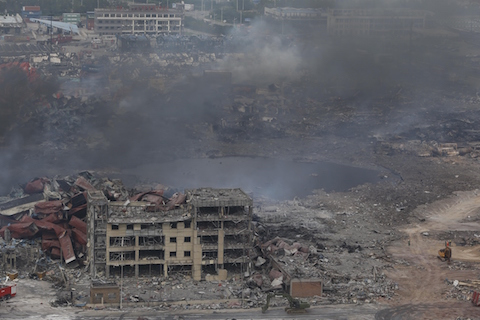 Smoke rises at the site of an explosion in Tianjin on Aug. 14, 2015. (STR/AFP/Getty Images)