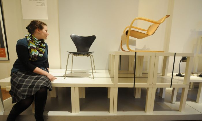 A woman looks at chairs on display at an exhibition of pieces by Swedish furniture designer Ikea in the northern German city of Hamburg on Nov. 4, 2009. The exhibition runs from November 6, 2009 to February 28, 2010. (NIGEL  Treblin/AFP/Getty Images)