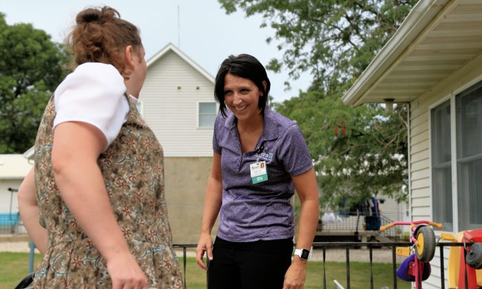 Nurse Kerri Lutjens chats with a Hutterite woman during a home visit at the Tschetter Colony near Olivet, S.D., Thursday, Aug. 13, 2015. Lutjens has spent the past few years gaining the trust of several communities of Hutterites, a deeply religious people, who live in insular farming communities in the Plains, Upper Midwest and Canada. (AP Photo/Nati Harnik)