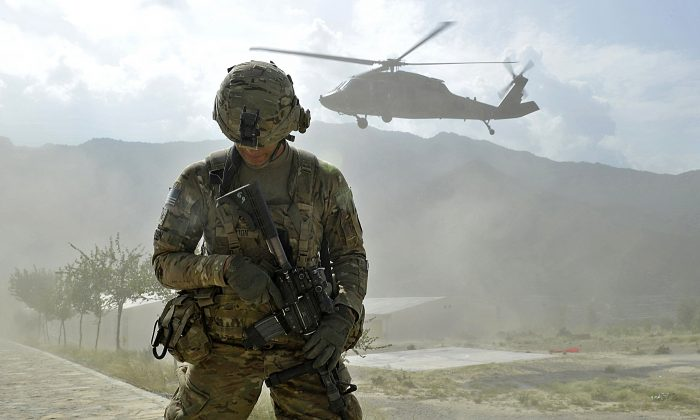 A soldier from the U.S. Army's Bravo Company secures a landing zone for a Black Hawk helicopter in Kunar Province, Afghanistan, on Sept. 15, 2011. (Tauseef Mustafa/AFP/Getty Images)