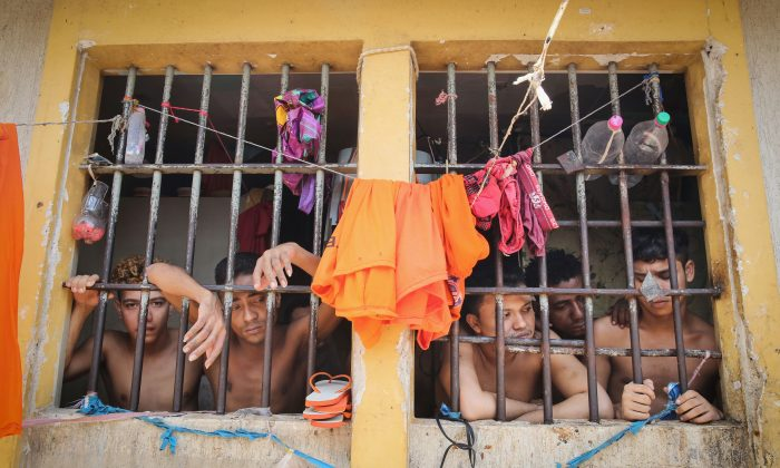 Inmates in a cell in the Pedrinhas Prison Complex, the largest penitentiary in Maranhão state, Brazil, on Jan. 27, 2015. Previously one of the most violent prisons in Brazil, Pedrinhas has seen efforts from a new state administration, new prison officials and judiciary leaders from Maranhão which appear to have quelled some of the unrest within the complex. In 2013, nearly 60 inmates were killed within the complex, including three who were beheaded during rioting. Critics believe overcrowding is one of the primary causes of rioting and violence in Brazil's prisons. Additionally, overcrowding has strengthened prison gangs which now span the country and control certain peripheries of cities including Rio de Janeiro, São Paulo and São Luis. Brazil now has the fourth-largest prison population in the world behind the United States, Russia and China. (Mario Tama/Getty Images)