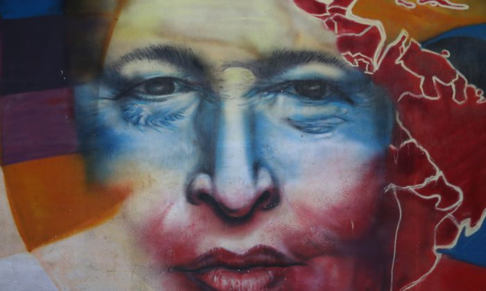 A mural of former Venezuelan President Hugo Chávez near the military barracks where Chávez is entombed, in Caracas, Venezuela, on March 4, 2014. (John Moore/Getty Images)