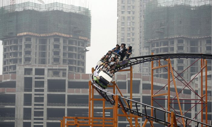 People ride a roller coaster in Chongqing Municipality, China, on Sept. 27, 2006. (China Photos/Getty Images)